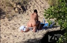 Sexy girl riding her lover on the beach